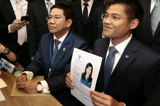 12-hour smiles: Thai Raksa Chart leader Preechaphol Pongpanich shows a document nominating Princess Ubolratana as the party's PM candidate at the Office of the Election Commission. By late evening, the smiles had evaporated. (Photo by Patipat Janthong)