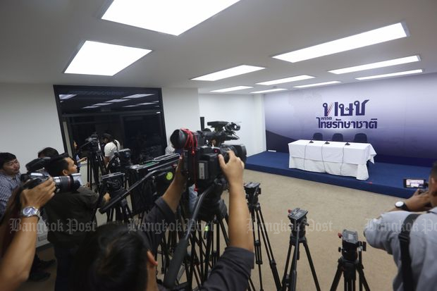 Photographers prepare for a briefing by the Thai Raksa Chart Party at its head office in Bangkok on Monday. The briefing was later cancelled because not enough members showed up. (Photo by Wisit Thamngern)