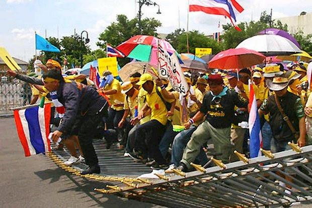 Supporters of the People's Alliance for Democracy (PAD) broke down the gates, seized the Government House compound and defied court orders to leave in August, 2008. They were declaring a 'final battle' against the government of then-prime minister Samak Sundaravej. (File photo, Reuters)
