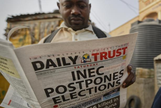 Nigerian presidential candidates urge for calm after election is postponed