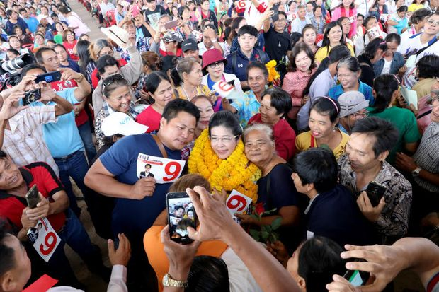 Sudarat Keyuraphan (centre), prime ministerial candidate for the Pheu Thai Party, poses for a photo with her supporters during an election campaign in Ubon Ratchathani Province, Thailand, on Monday. (Reuters photo)