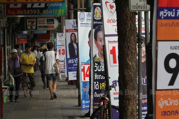 Campaign posters lining a street in Thon Buri area on Feb 12, 2018. (Photo by Apichart Jinakul)