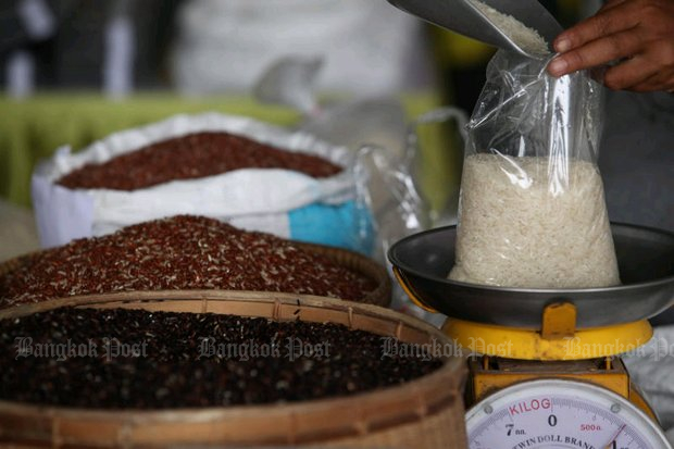 Various types of rice on sale in a Bangkok market. Farm groups are closely watching the progress of the Rice Bill, and have promised 'huge protests' if it is not amended. (Photo by Wichan Charoenkiatpakul)