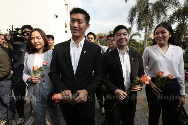 Future Forward Party leader Thanathorn Juangroongruangkit, blackjacket left, and  party executives at the Office of the Attorney-General in Bangkok on Wednesday, when police asked state prosecutors to indict them for computer crime. (Photo by Patipat Janthong)