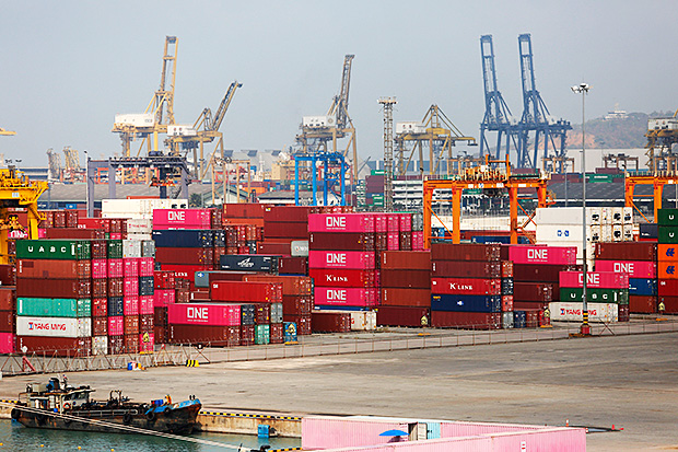 Cranes and containers sit at Laem Chabang port. (Photo by Pattarapong Chatpattarasill)