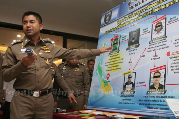 Pol Lt Gen Surachate Hakparn announces the arrest of three people, including two immigration police, involved in the issuing of fake visa stamps, at a media conference on Tuesday. (Photo by Apichit Jinakul)