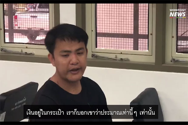 Taxi driver Supachoke Singkhon, 36, tells his side of the story about the 1,800-baht ride he gave two out-of-towners at the Pak Khlong Rangsit police station in Pathum Thani. (Screen capture from Workpoint News TV)