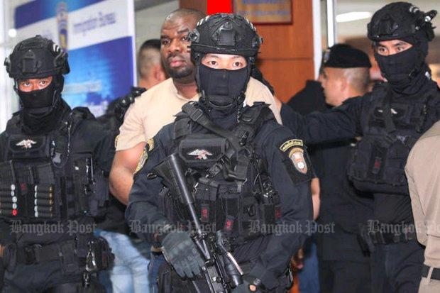 Police claim this Nigerian man, allowed to identify himself as 'Paul Smith Brown, 34' hired Thai women to fly overseas and mule drugs back to him in Bangkok. (Photo by Pawat Laopaisarntaksin)