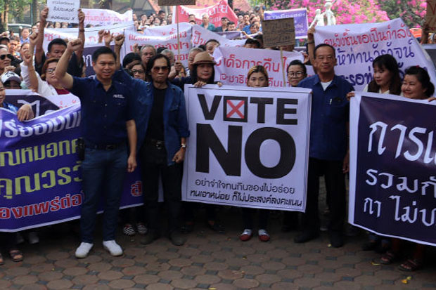Woravat Auapinyakul, front left, a former member of the disbanded Thai Raksa Chart party, is flanked by supporters in Phrae province, where a