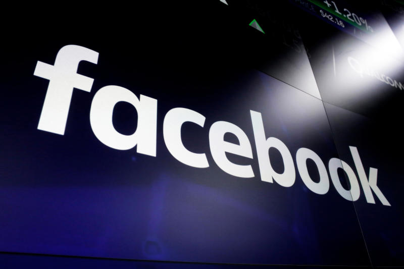 A day not to 'like' for Facebook, hit by outage, criminal probe