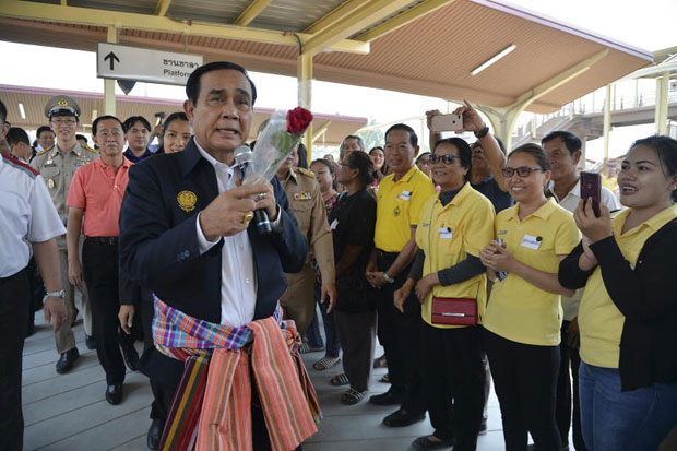 Prime Minister Prayut Chan-o-cha greets people as he opens the upgraded Khon Kaen train station in Khon Kaen province on Wednesday. (Government House photo)