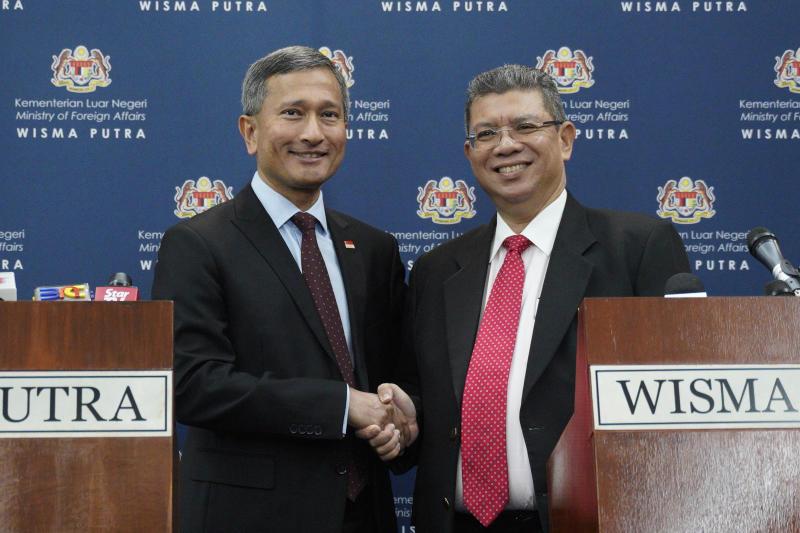 Singapore, Malaysia shelve dispute to cool tensions