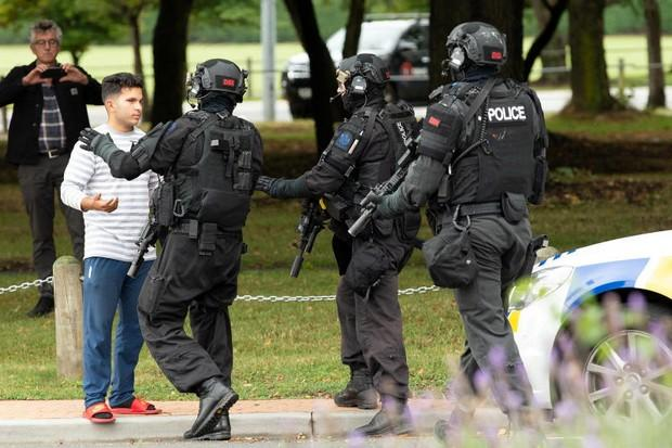 Armed Offenders Squad members push back members of the public following the shooting at the Masjid Al Noor mosque in Christchurch. (Reuters photo)