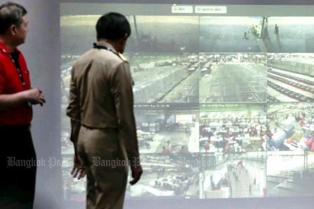 Election Commission and Thailand Post security officers watch on CCTV the sorting of ballots Monday by more than 3,000 Thailand Post employees. Overseas and early-voting ballots must be sent to constituencies for counting this coming Sunday. (Photo by Patipat Janthong)
