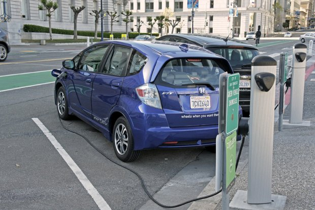 A Honda Fit EV recharges at a public station in front of San Francisco City Hall. (Creative Commons via Flickr)