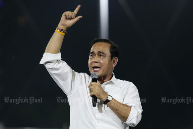 Prime Minister Prayut Chan-o-cha makes his first campaign speech from the stage of the Palang Pracharath rally at Thephasadin Stadium in Bangkok on Friday night. (Photo by Patipat Janthong)