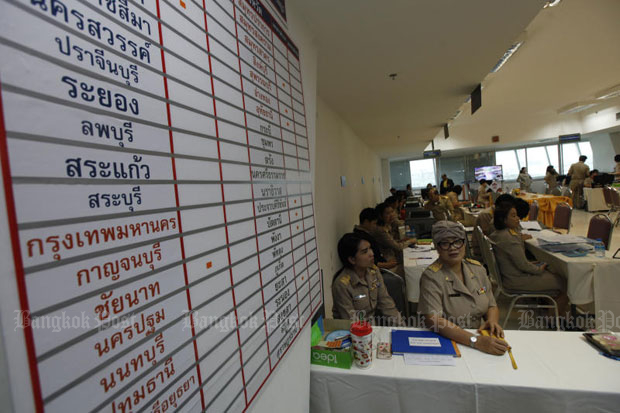 Officials of the Election Commission at the vote count room at the EC office in Bangkok on Monday (photo by Varuth Hirunyatheb)