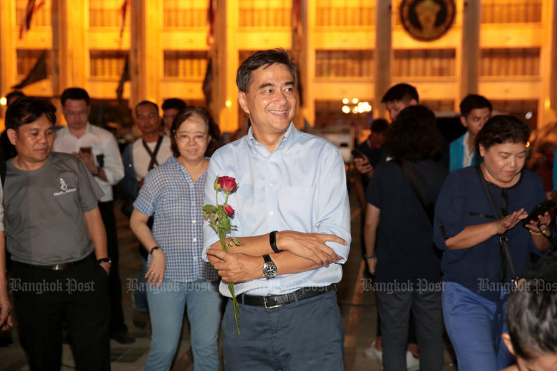 Then Democrat leader Abhisit Vejjajiva in a cheerful pre-polls moment, during the party's last major campaign rally, at Lan Khon Muang, outside City Hall, on March 22. (Photo by Chanat Katanyu)