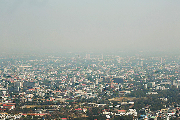 The city of Chiang Mai, as seen from Doi Suthep, covered with heavy smog.