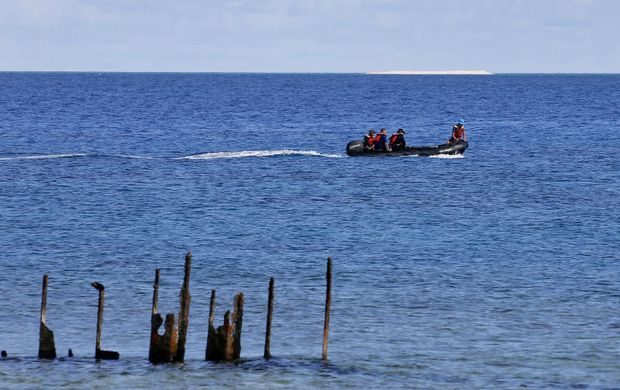 In this April 21, 2017, photo, engineers from NAMRIA, the central mapping agency of the Philippine Government, survey the area around the Philippine-claimed Thitu Island with a sandbar sitting on the horizon off the disputed South China Sea in western Philippines. (AP file photo)