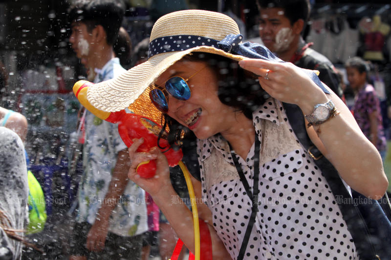 A tourist enjoys getting wet during the Songkran festival on Khaosan Road in April last year. (Photo by Apichart Jinakul)