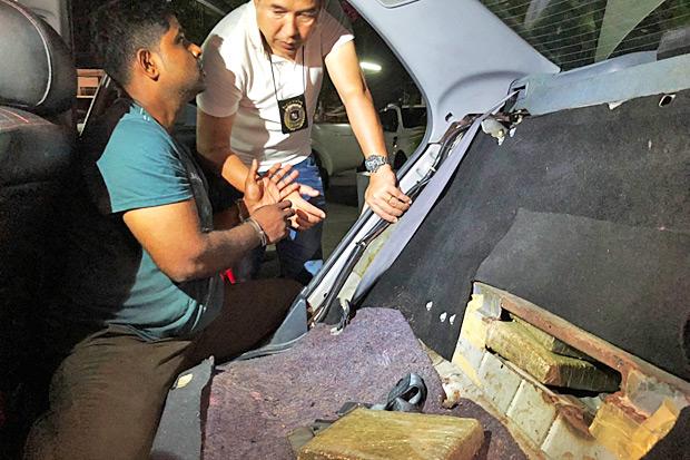 A Malaysian arrested with 64 kilogrammes of dried marijuana. (Photo by Assawin Pakkawan)