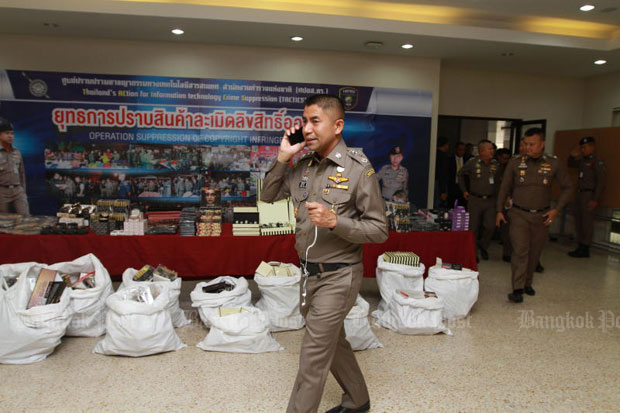 Pol Lt Gen Surachate Hakparn, then immigration police chief, seen at a news  conference on suppression of pirated cosmetics at the Royal Thai Police Office in Bangkok on Friday. Later that night he was abruptly removed from the position. (Photo by Somchai Poomlard)