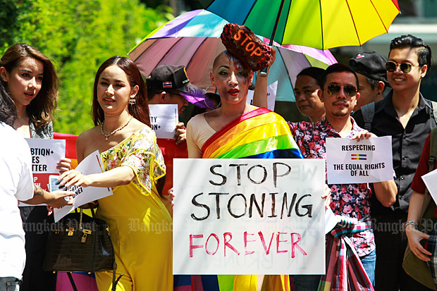 Shocked by Sharia: Members of an LGBT group hold a rally to protest against Brunei's imposition of full Sharia law, which punishes homosexual sex and adultery by stoning offenders to death, outside the Brunei embassy in Bangkok on Tuesday. (Photo by Somchai Poomlard)