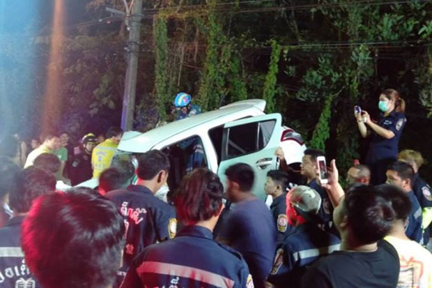 The white Suzuki Swift rest on a bridge rail guard after being fatally hit by a Mercedes-Benz of a drunk driver in Thawi Watthana district, Bangkok, on early Friday morning. (Poh Teck Tung Foundation photo)