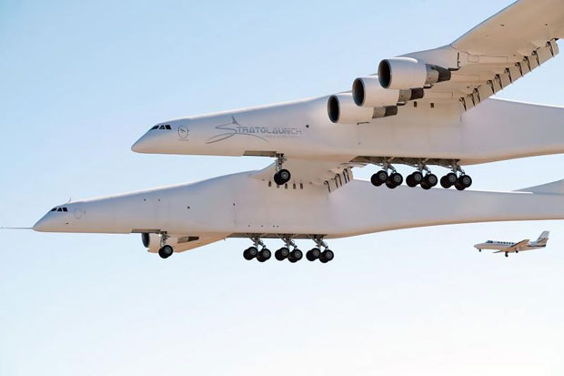 This handout photograph obtained courtesy of Stratolaunch shows the Stratolaunch plane flying over the California desert, April 13, 2019, the first test flight of the US company's gigantic aircraft whose wingspan is almost half that of an Airbus A380. The strange aircraft, built by the legendary aeronautical engineering company Scaled Composites in the Mojave Desert, has two fuselages and is powered by six Boeing 747 engines. It must theoretically be used to carry and drop at altitude a small rocket that will then light its engine, and will propel to space to place satellites in orbit. This is a more flexible method of accessing the space than vertical rocket takeoffs, as a large take-off runway would suffice. (Photo by Handout / Stratolaunch Systems Corp / AFP)
