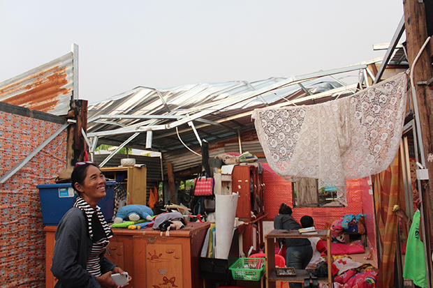 Champa Saikrueng looks at her damaged house at Ban Don Krachai in Khon Buri district of Nakhon Ratchasima on Monday after strong winds blew away the roof. (Photo by Prasit Tangprasert)