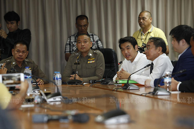 Future Forward Party secretary-general Piyabutr Saengkanokkul denies charges against him during a meeting with police at the Technology Computer Crime Suppression Division. (Photo by Varuth Hirunyatheb)