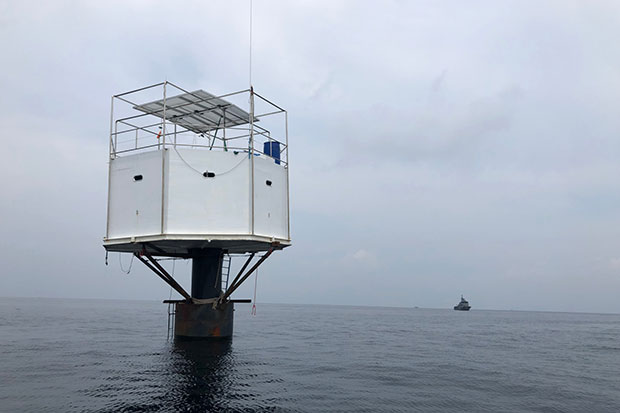 This floating living platform, built off the coast of Phuket by an American man and his Thai wife, will be removed within one week, says the Third Navy Area commander. (Supplied photo via Achadtaya Chuenniran)
