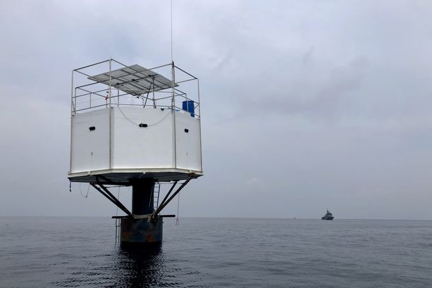 A photo provided by Royal Thai Navy shows a floating home lived in by an American man and his Thai partner in the Andaman Sea, off Phuket island. (Royal Thai Navy via AP)