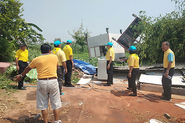 Officials inspect damage after a severe storm lifted a house off its foundations in Muang district of Kalasin. (Photo by Yongyut Phupuangphet)