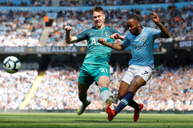 Manchester City's Raheem Sterling and Tottenham's Juan Foyth vie for the ball in their Premier League Match on Saturday at Etihad Stadium in Manchester.