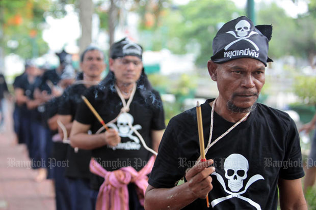 Activists perform a ritual symbolising their resistance to government-approved pesticides such as paraquat and chlorpyrifos, at Government House last year. (Photo by Tawatchai Kemgumnerd)