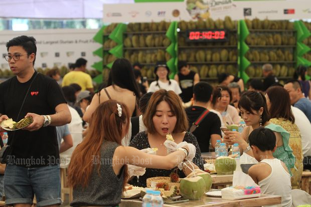 Thai and foreign tourists eat Thai fruit at the Original Thailand's Amazing Durian and Fruit Fest 2019, an all-you-can eat buffet, which costs 479 baht per person held by Tops Supermarket, the Internal Trade Department and CentralWorld shopping centre, on April 19. (Photo by Apichart Jinakul)