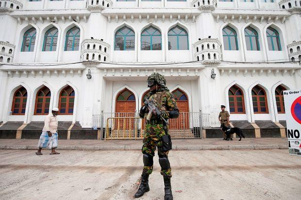 Sri Lankan security forces find 15 bodies, including children, after raiding house