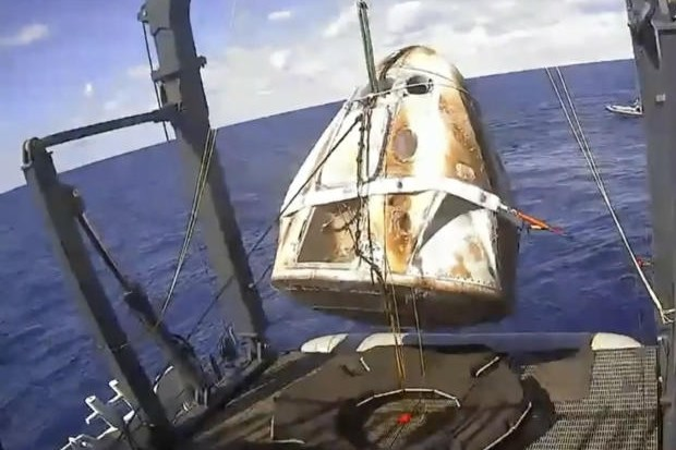 The SpaceX Crew Dragon capsule is hoisted onto a ship in the Atlantic Ocean off the Florida coast after it returned from an unmanned mission to the International Space Station.  The capsule for was destroyed during a ground test on April 20 art as Cape Canaveral, SpaceX admitted on Thursday. (Photo:Nasa/AP file)