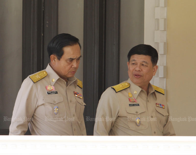 Natural Resources and Environment Minister Surasak Kanchanarat (right) is expected to resign and join the ranks of the new senate. (Bangkok Post file photo)