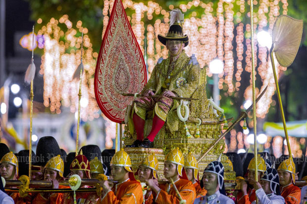 His Majesty the King, seated on the royal palanquin Budtan Thong, makes his way along Ratchadamnoen Klang Avenue during the 'Liap Phranakhon' procession along a seven-kilometre route as part of the lavish coronation ceremony Sunday's evening. (Photo by Pattarapong Chatpattarasill)