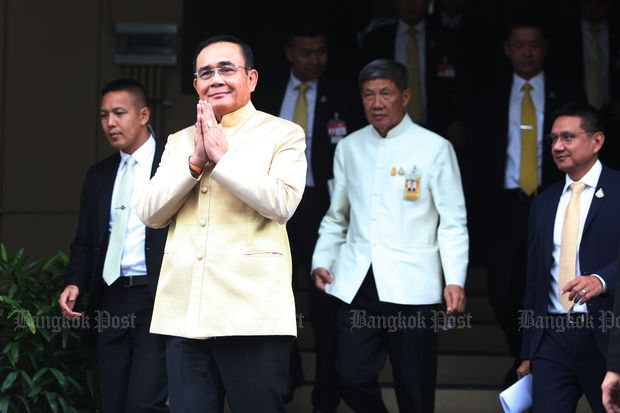 Prime Minister Prayut Chan-o-cha arrives at Government House for the cabinet meeting on Tuesday. (Photo by Pawat Laupaisarntaksin)