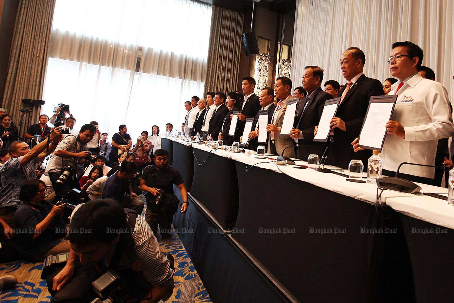 Representatives of the Pheu Thai Party and its allies announce their coalition plan in Bangkok on March 27. (Photo by Prakrit Janthawong)