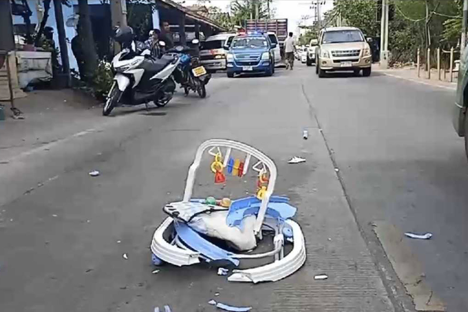 The crushed baby walker rests on the road after it was run over by a 10-wheeler in Phra Samut Chedi district of Samut Prakan on Thursday afternoon. (Photo by Sutthiwit Chayutworakan)