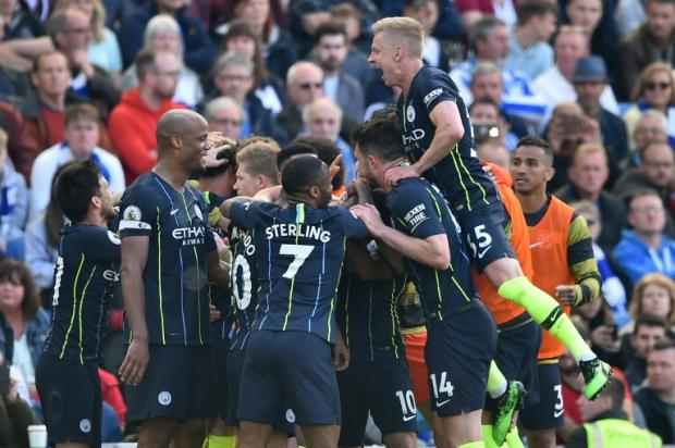 Premier League champions Manchester City celebrate their third goal against Brighton. (AFP photo)