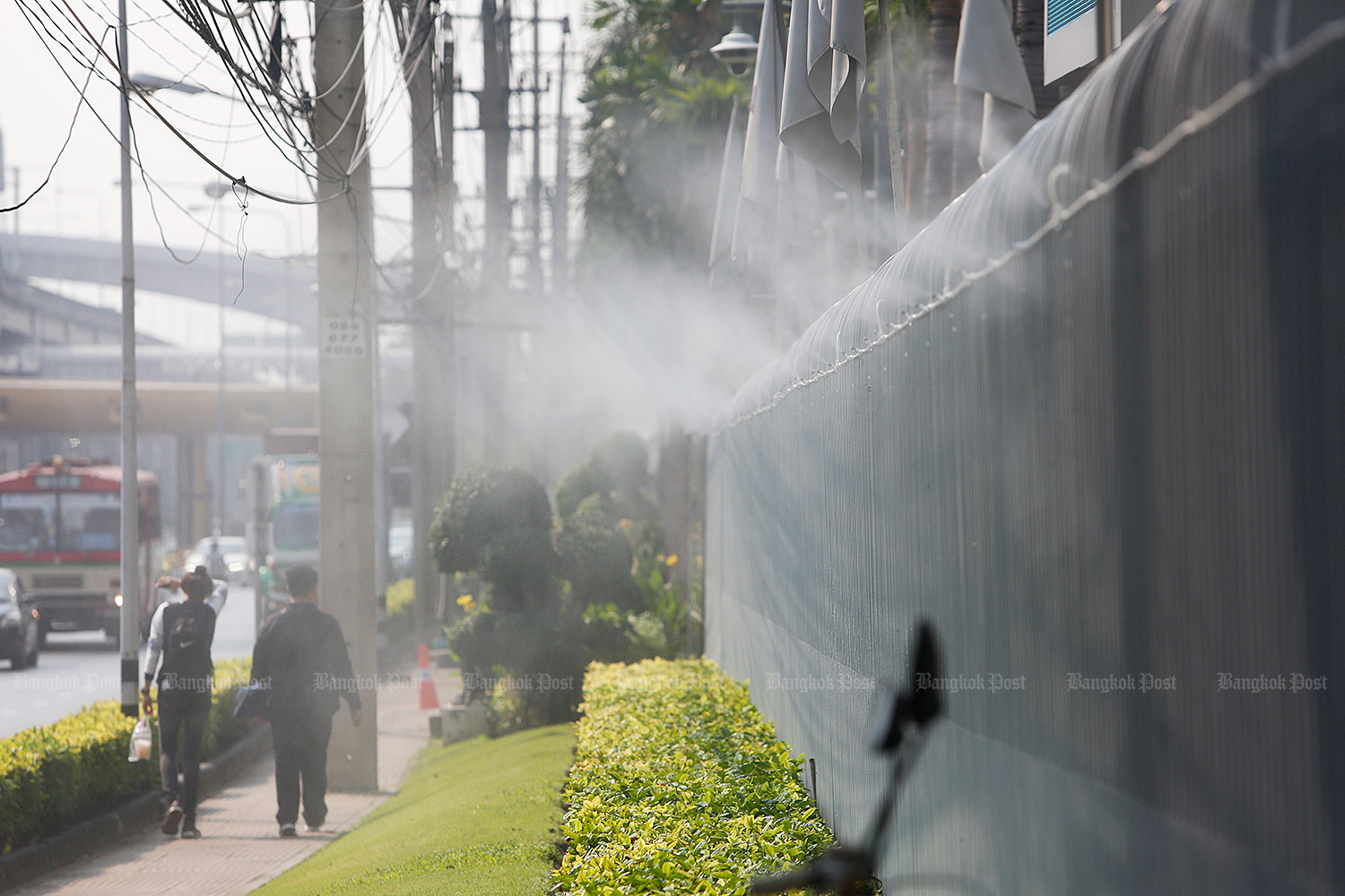 Mist is released at PTT's head office to ease dust pollution in Bangkok. (Photo by Pattarapong Chatpattarasill)