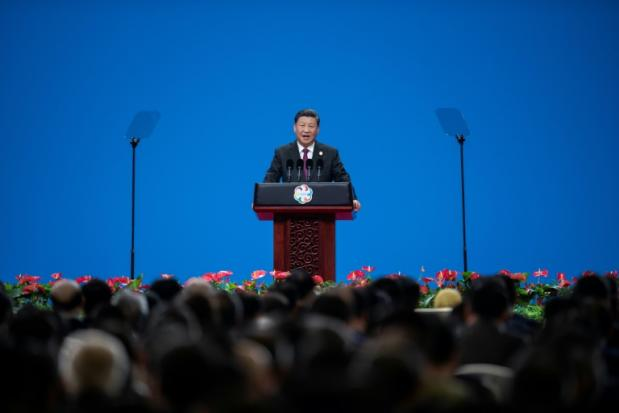 As trade war bites, China's Xi preaches openness