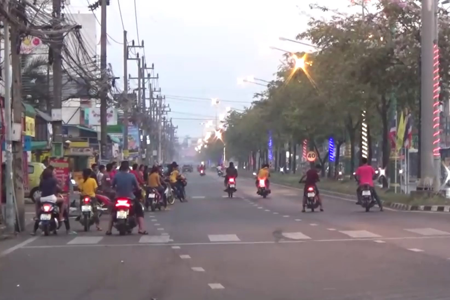 Police round up 32 motorcyclists racing through the heart of Hat Yai city on Sunday. (Photo by Assawan Pakkawan)