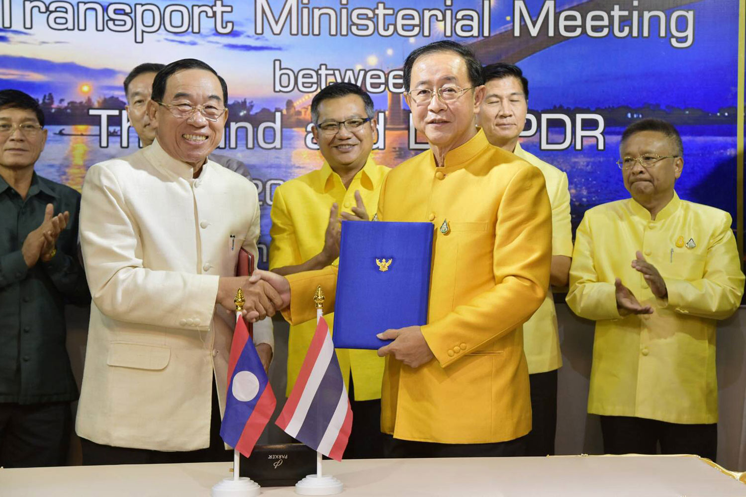 Laos' Minister of Public Works and Transport Bounchanh Sinthavong (left) shakes hands with Thai Transport Minister Arkhom Termpittayapaisith at the transport ministerial meeting at Amanta Hotel in Nong Khai province on May 20. (Supplied Photo via Thodsapol Hongtong)